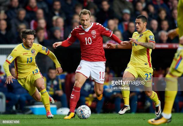 Christian Eriksen of Denmark Mihail Baluta of Romania and Nicolae Stanciu of Romania compete for the ball during the FIFA World Cup 2018 qualifier...