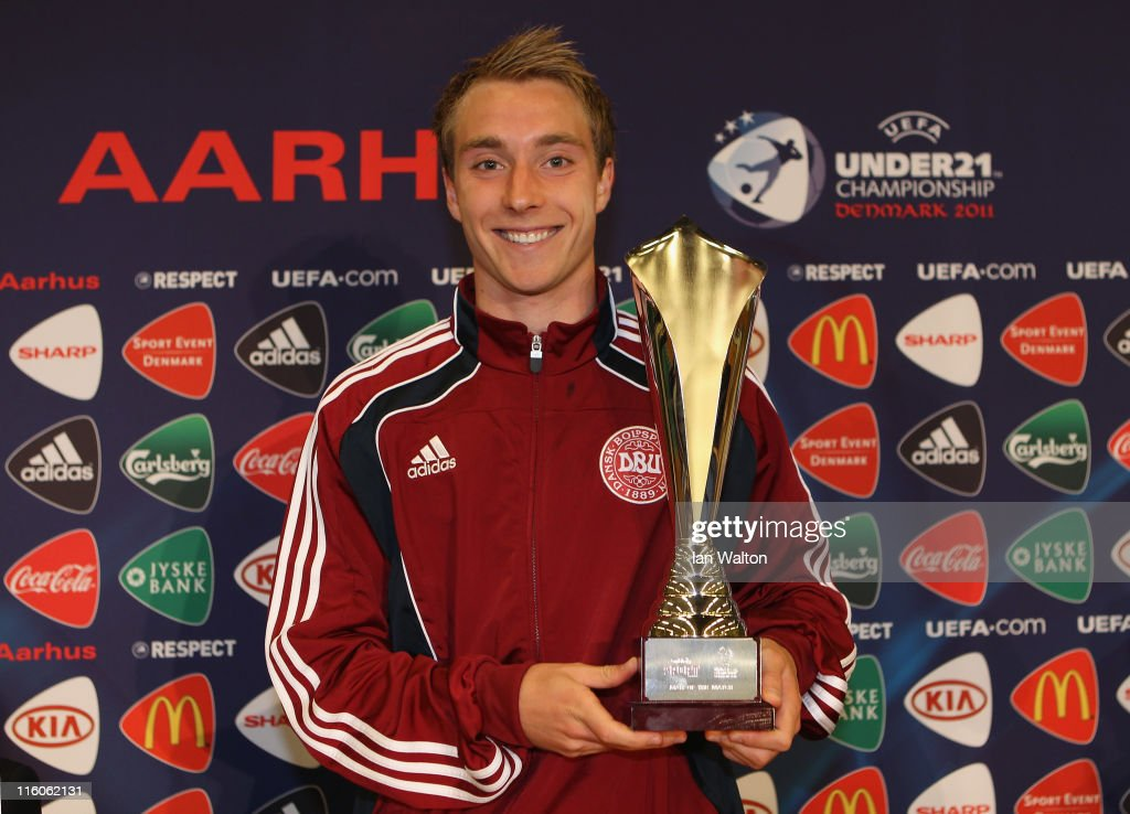 <a gi-track='captionPersonalityLinkClicked' href=/galleries/search?phrase=Christian+Eriksen&family=editorial&specificpeople=6757192 ng-click='$event.stopPropagation()'>Christian Eriksen</a> of Denmark receives the Man Of The Match trophy after the UEFA European Under-21 Championship Group A match between Denmark and Belarus at the Aarhus stadium on on June 14, 2011 in Aarhus, Denmark.