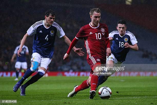 Christian Eriksen of Denmark vies with Gordon Greer and John McGinn of Scotland during the International Friendly match between Scotland and Denmark...