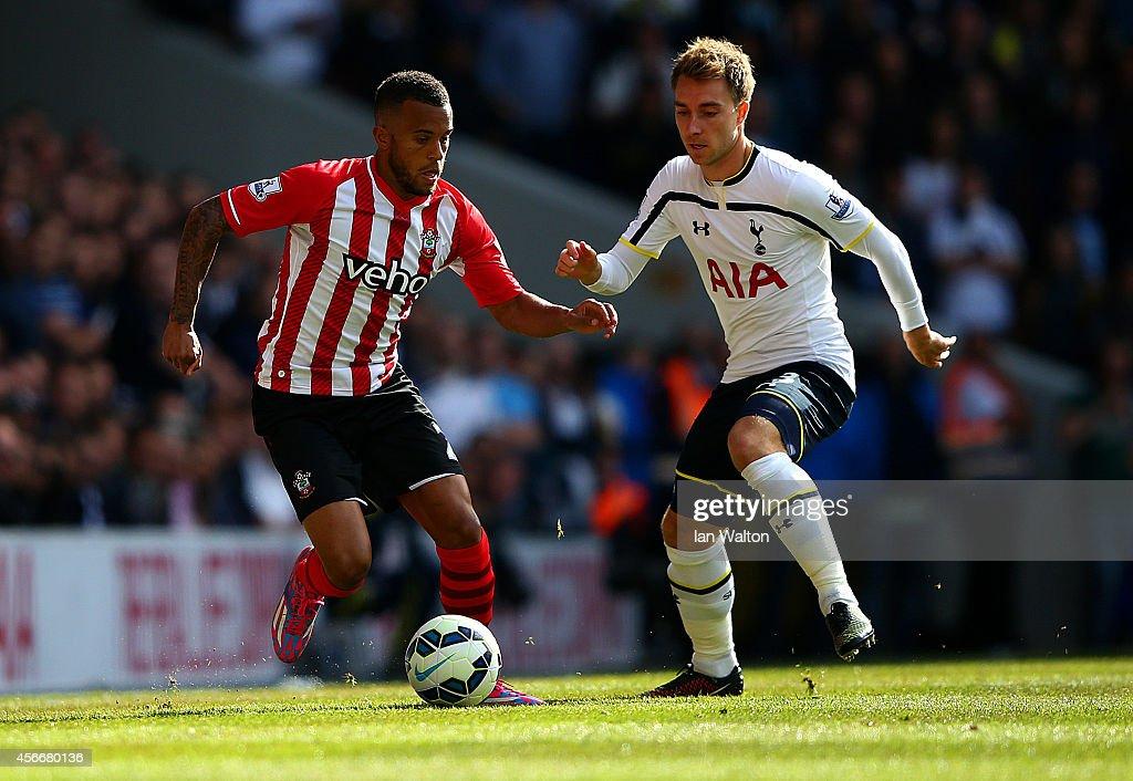 Christian Eriksen of Spurs battles for the ball with Ryan Bertrand of Southampton during the Barclays Premier League match between Tottenham Hotspur...