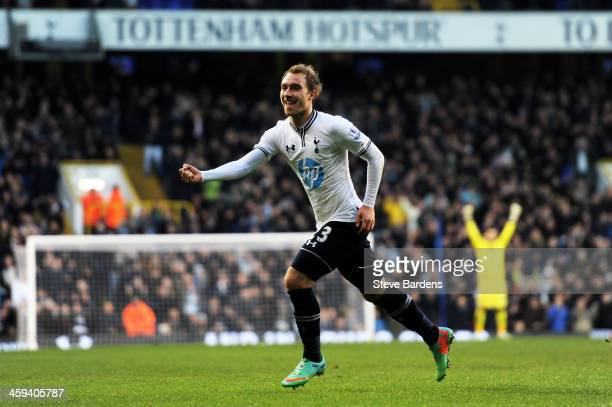 Christian Eriksen of Spurs celebrates after scoring the opening goal from a free kick during the Barclays Premier League match between Tottenham...