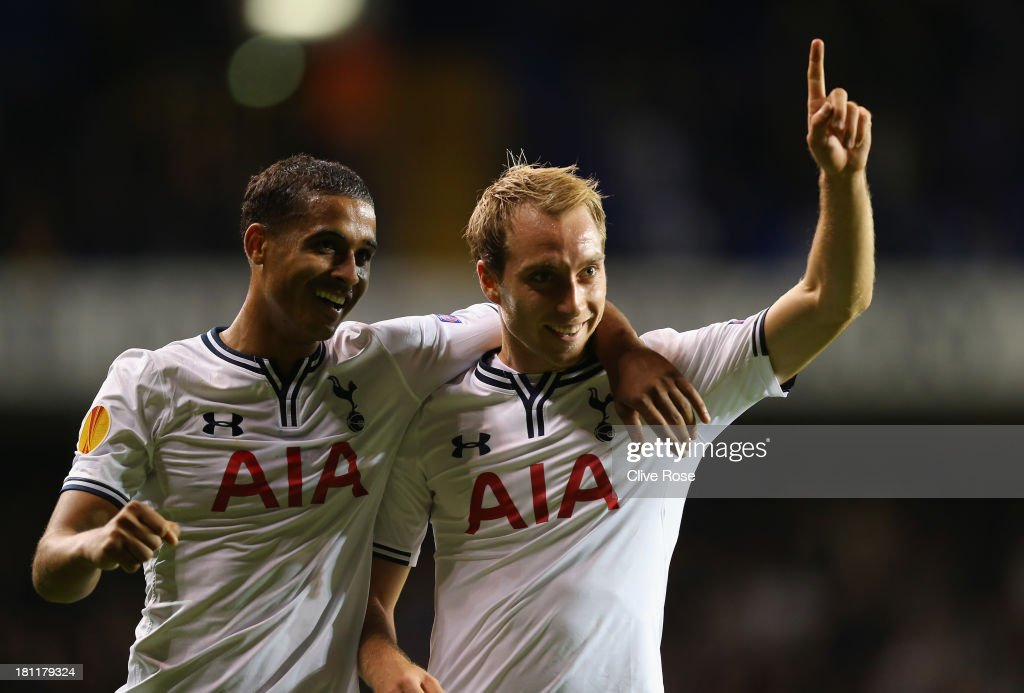 <a gi-track='captionPersonalityLinkClicked' href=/galleries/search?phrase=Christian+Eriksen&family=editorial&specificpeople=6757192 ng-click='$event.stopPropagation()'>Christian Eriksen</a> of Spurs celebrates scoring their third goal with <a gi-track='captionPersonalityLinkClicked' href=/galleries/search?phrase=Kyle+Naughton&family=editorial&specificpeople=5635202 ng-click='$event.stopPropagation()'>Kyle Naughton</a> of Spurs during the UEFA Europa League Group K match between Tottenham Hotspur FC and Tromso IL at White Hart Lane on September 19, 2013 in London, England.
