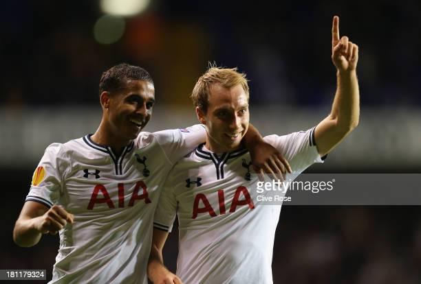 Christian Eriksen of Spurs celebrates scoring their third goal with Kyle Naughton of Spurs during the UEFA Europa League Group K match between...