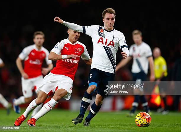 Christian Eriksen of Spurs holds off Kieran Gibbs of Arsenal during the Barclays Premier League match between Arsenal and Tottenham Hotspur at the...