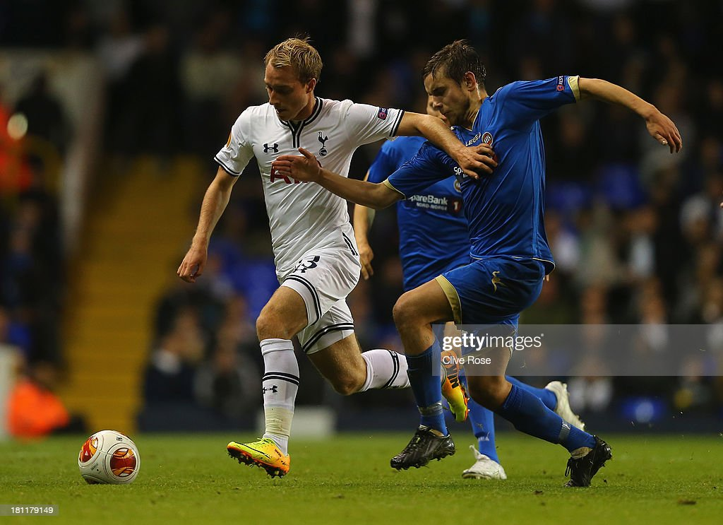Christian Eriksen of Spurs holds off Remi Johansen of Trosmo during the UEFA Europa League Group K match between Tottenham Hotspur FC and Tromso IL at White Hart Lane on September 19, 2013 in London, England.