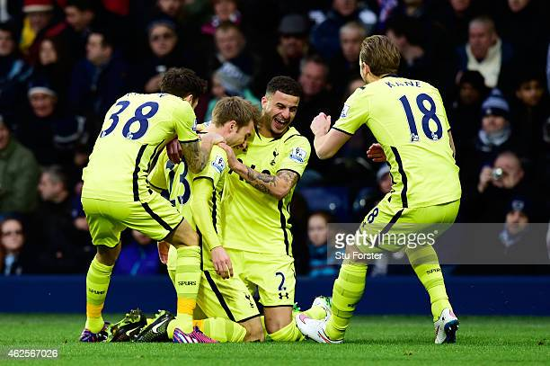 Christian Eriksen of Spurs is congratulated by teammates after scoring the opening goal during the Barclays Premier League match between West...