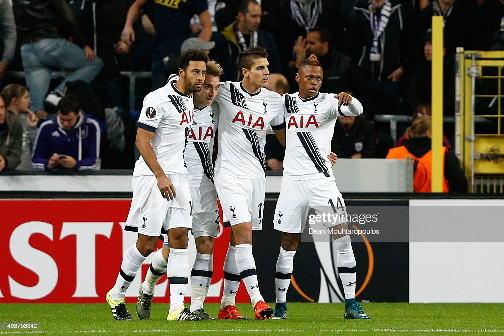 <a gi-track='captionPersonalityLinkClicked' href=/galleries/search?phrase=Christian+Eriksen&family=editorial&specificpeople=6757192 ng-click='$event.stopPropagation()'>Christian Eriksen</a> (2nd L) of Spurs is congratulated by teammates after scoring the opening goal during the UEFA Europa League Group J match between RSC Anderlecht and Tottenham Hotspur FC at the Constant Vanden Stock Stadium on October 22, 2015 in Brussels, Belgium.