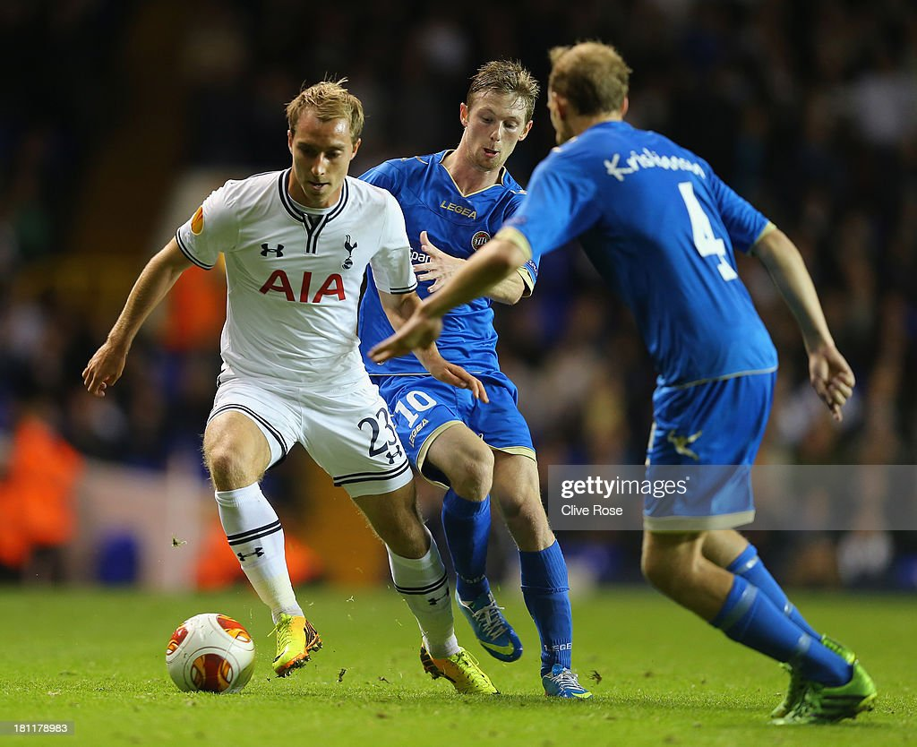 Christian Eriksen of Spurs is marshalled by Thomas Drage of Trosmo during the UEFA Europa League Group K match between Tottenham Hotspur FC and Tromso IL at White Hart Lane on September 19, 2013 in London, England.