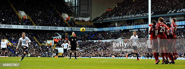 Christian Eriksen of Spurs scores the opening goal from a free kick during the Barclays Premier League match between Tottenham Hotspur and West...
