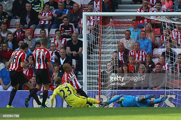 Christian Eriksen of Spurs scores their second goal past Vito Mannone of Sunderland during the Barclays Premier League match between Sunderland and...