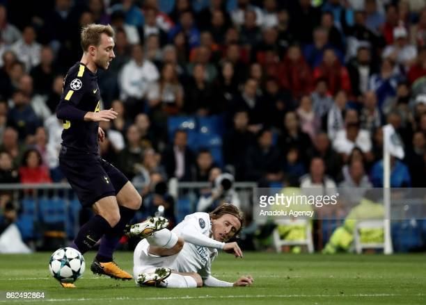 Christian Eriksen of Totenham in action against Luka Modric of Real Madrid during UEFA Champions League Group H match between Real Madrid and...