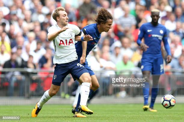 Christian Eriksen of Tottenham Hotspur and David Luiz of Chelsea battle for possession during the Premier League match between Tottenham Hotspur and...