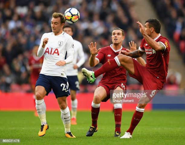 Christian Eriksen of Tottenham Hotspur and Dejan Lovren of Liverpool during the Premier League match between Tottenham Hotspur and Liverpool at...