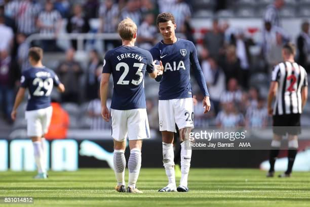 Christian Eriksen of Tottenham Hotspur and Dele Alli of Tottenham Hotspur celebrate at full time during the Premier League match between Newcastle...