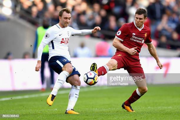 Christian Eriksen of Tottenham Hotspur and James Milner of Liverpool battle for possession during the Premier League match between Tottenham Hotspur...