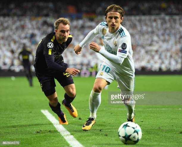 Christian Eriksen of Tottenham Hotspur and Luka Modric of Real Madrid battle for posession during the UEFA Champions League group H match between...