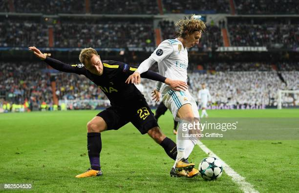 Christian Eriksen of Tottenham Hotspur and Luka Modric of Real Madrid battle for possession during the UEFA Champions League group H match between...