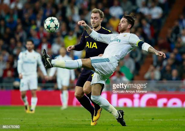 Christian Eriksen of Tottenham Hotspur and Sergio Ramos of Real Madrid battle for possession during the UEFA Champions League group H match between...