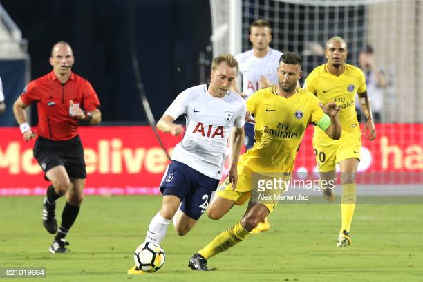 Christian Eriksen of Tottenham Hotspur and Thiago Motta of Paris SaintGermain chase the ba lduring the International Champions Cup 2017 match between...