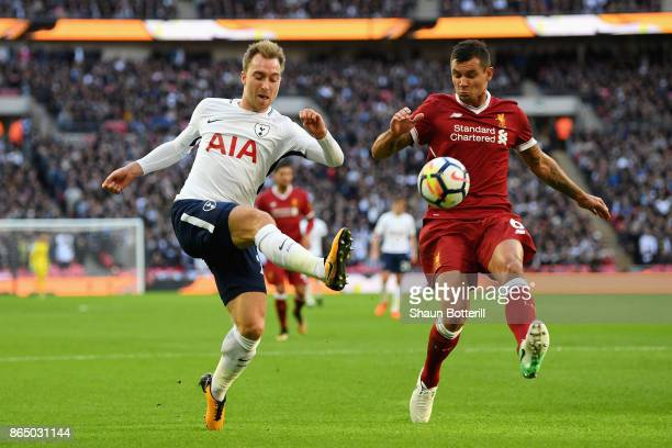 Christian Eriksen of Tottenham Hotspur attempts to cross the ball while under pressure from Dejan Lovren of Liverpool during the Premier League match...
