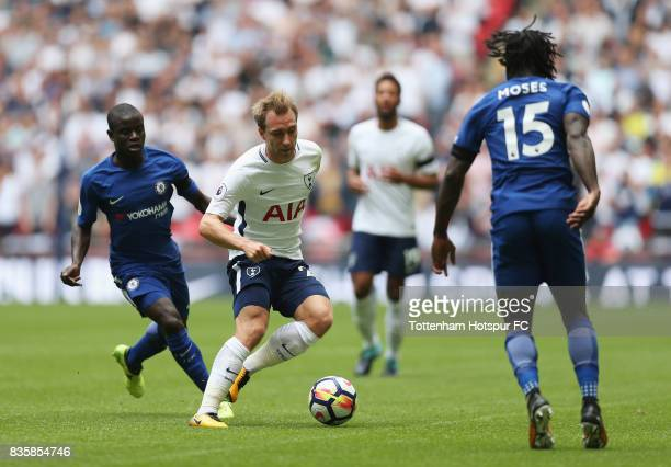 Christian Eriksen of Tottenham Hotspur attempts to get away from N'Golo Kante of Chelsea during the Premier League match between Tottenham Hotspur...