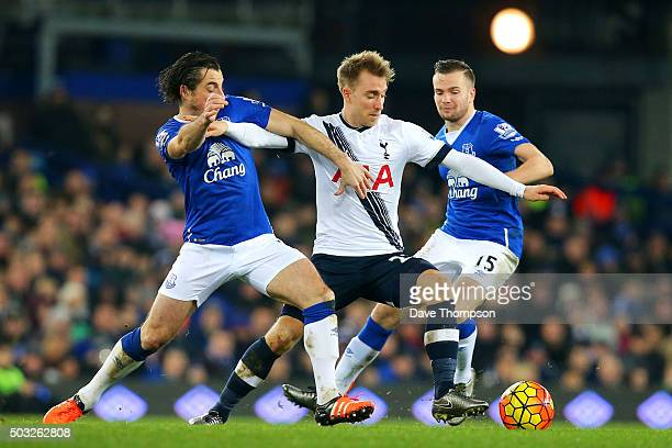Christian Eriksen of Tottenham Hotspur battles for the ball with Leighton Baines and Tom Cleverley of Everton during the Barclays Premier League...