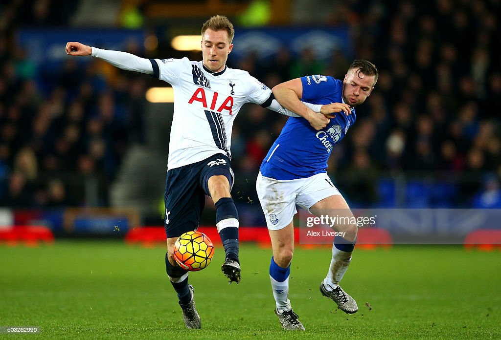 Christian Eriksen of Tottenham Hotspur battles for the ball with Tom Cleverley of Everton during the Barclays Premier League match between Everton and Tottenham Hotspur at Goodison Park on January 3, 2016 in Liverpool, England.