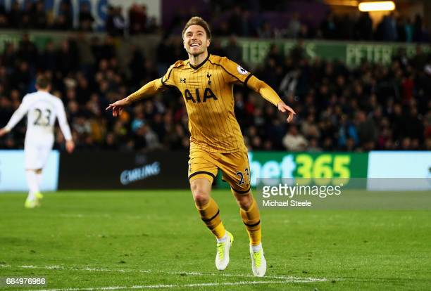 Christian Eriksen of Tottenham Hotspur celebrates scoring his sides third goal during the Premier League match between Swansea City and Tottenham...