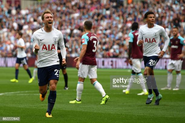 Christian Eriksen of Tottenham Hotspur celebrates scoring his sides third goal during the Premier League match between West Ham United and Tottenham...