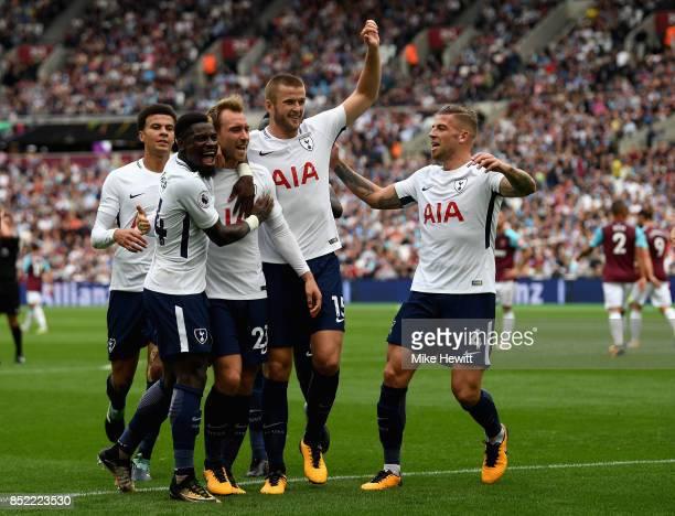 Christian Eriksen of Tottenham Hotspur celebrates scoring his sides third goal with his Tottenham Hotspur team mates during the Premier League match...