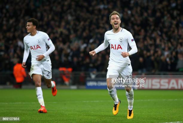 Christian Eriksen of Tottenham Hotspur celebrates scoring his side's third goal during the UEFA Champions League group H match between Tottenham...