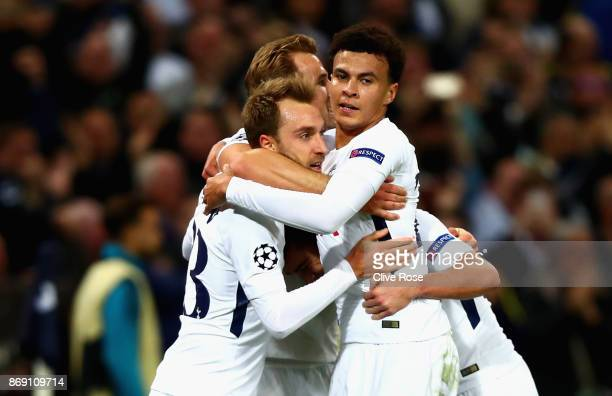 Christian Eriksen of Tottenham Hotspur celebrates scoring his side's third goal with team mates during the UEFA Champions League group H match...