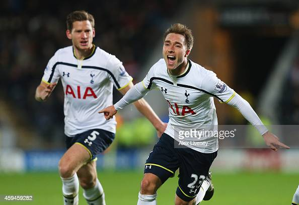 Christian Eriksen of Tottenham Hotspur celebrates scoring the winning goal with Jan Vertonghen during the Barclays Premier League match between Hull...
