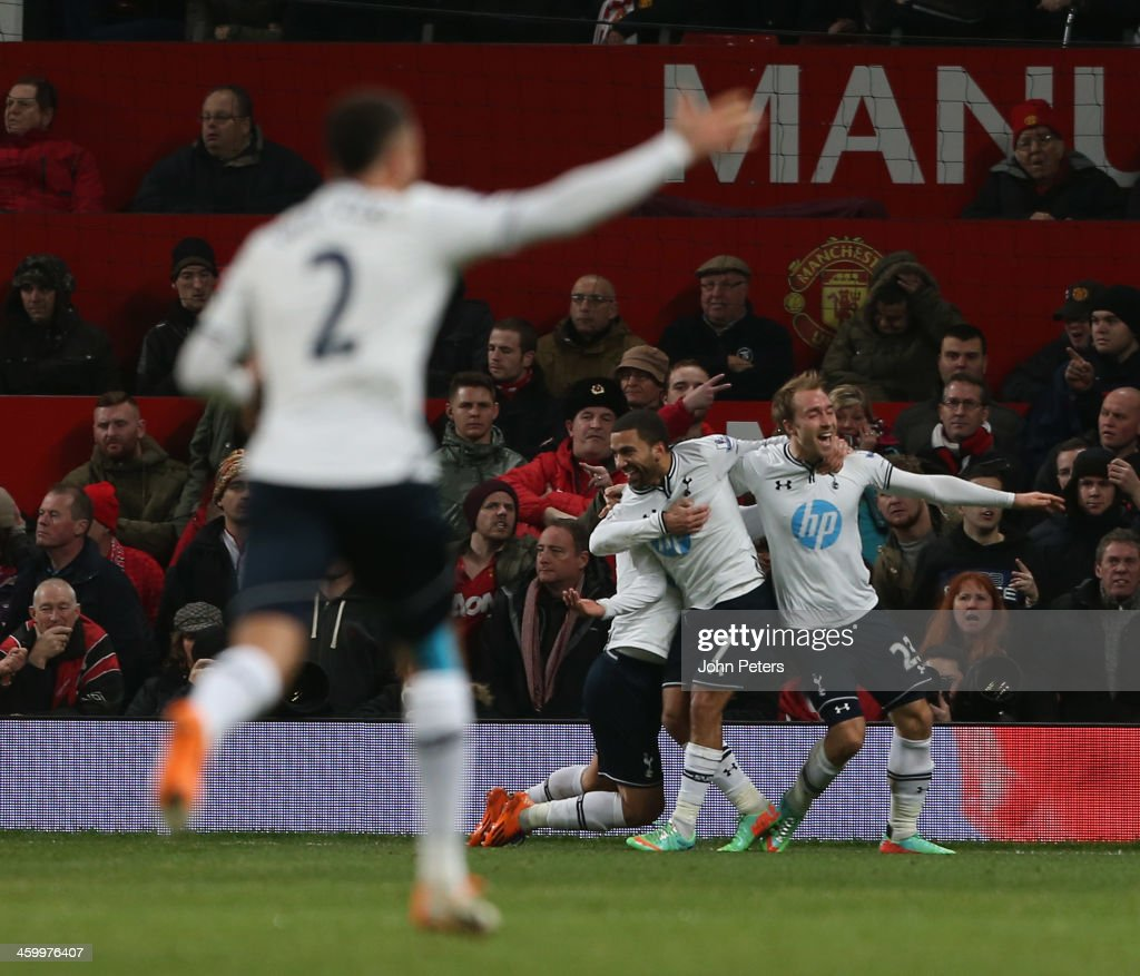 Christian Eriksen of Tottenham Hotspur (R) celebrates scoring their second goal during the Barclays Premier League match between Manchester United and Tottenham Hotspur at Old Trafford on January 1, 2014 in Manchester, England.