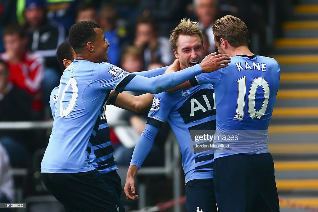 Christian Eriksen (C-R) of Tottenham Hotspur celebrates scoring Tottenham's second goal during the Barclays Premier League match between Swansea City and Tottenham Hotspur at Liberty Stadium on October 4, 2015 in Swansea, Wales.