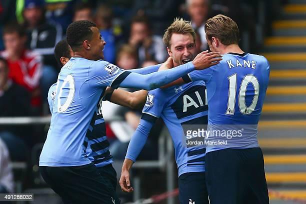Christian Eriksen of Tottenham Hotspur celebrates scoring Tottenham's second goal during the Barclays Premier League match between Swansea City and...