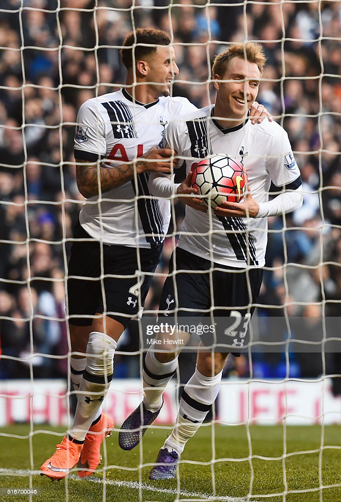 Christian Eriksen of Tottenham Hotspur (23) celebrates with team mate Kyle Walker as he scores their third goal during the Barclays Premier League match between Tottenham Hotspur and A.F.C. Bournemouth at White Hart Lane on March 20, 2016 in London, United Kingdom.