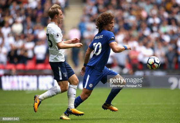 Christian Eriksen of Tottenham Hotspur chases David Luiz of Chelsea during the Premier League match between Tottenham Hotspur and Chelsea at Wembley...