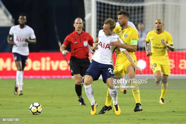Christian Eriksen of Tottenham Hotspur gets held by Thiago Motta of Paris SaintGermain during the International Champions Cup 2017 match between...