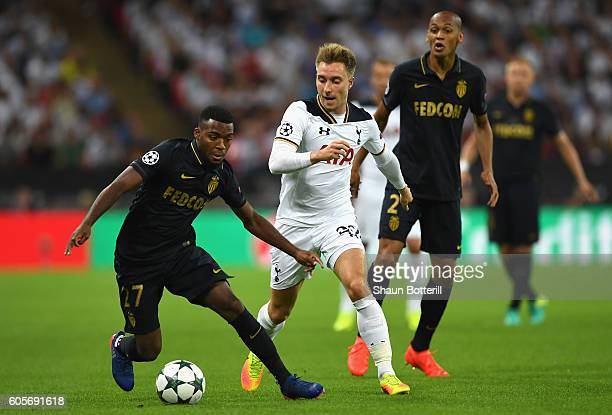 Christian Eriksen of Tottenham Hotspur holds off Fabinho and Thomas Lemar of AS Monaco during the UEFA Champions League match between Tottenham...