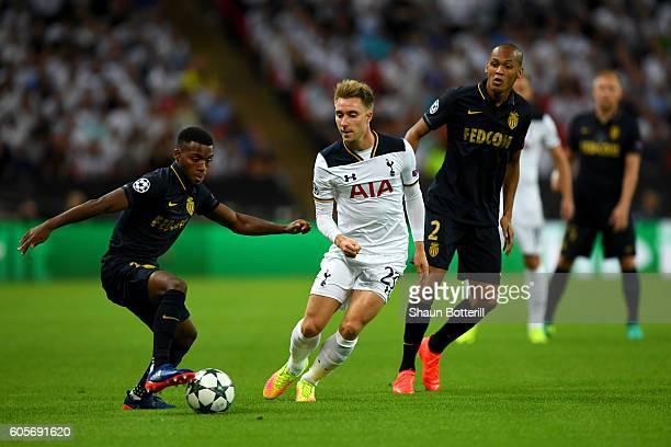Christian Eriksen of Tottenham Hotspur holds off Fabinho and Thomas Lemar of AS Monaco during the UEFA Champions League match between Tottenham...