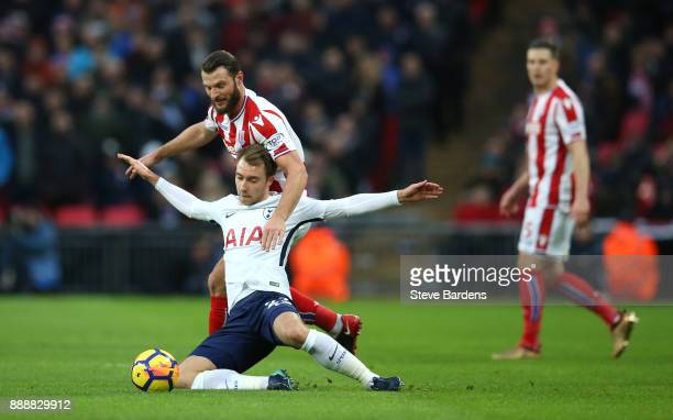 Christian Eriksen of Tottenham Hotspur is challenged by Erik Pieters of Stoke City during the Premier League match between Tottenham Hotspur and...