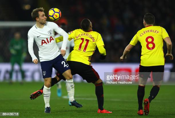 Christian Eriksen of Tottenham Hotspur is challenged by Richarlison de Andrade of Watford during the Premier League match between Watford and...