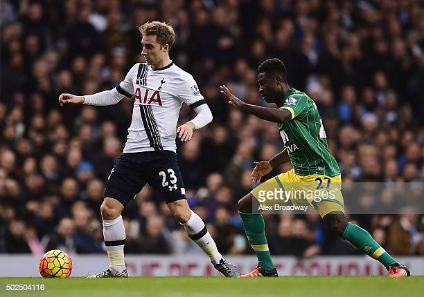 Christian Eriksen of Tottenham Hotspur is closed down by Alexander Tettey of Norwich City during the Barclays Premier League match between Tottenham...