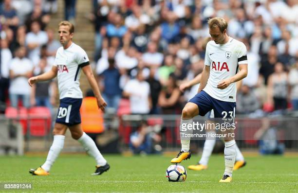 Christian Eriksen of Tottenham Hotspur is dejected after Chelsea score their first goal during the Premier League match between Tottenham Hotspur and...