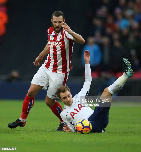 Christian Eriksen of Tottenham Hotspur is fouled by Erik Pieters of Stoke City during the Premier League match between Tottenham Hotspur and Stoke...