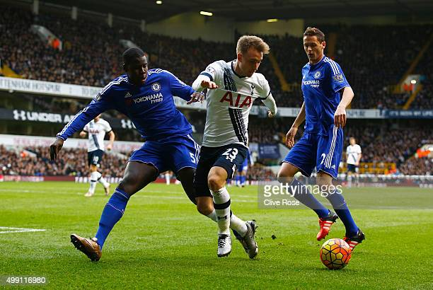 Christian Eriksen of Tottenham Hotspur is marshalled by Kurt Zouma and Nemanja Matic of Chelsea during the Barclays Premier League match between...