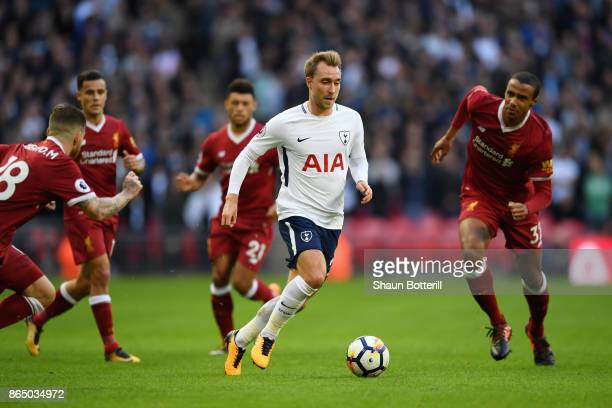 Christian Eriksen of Tottenham Hotspur is put under pressure during the Premier League match between Tottenham Hotspur and Liverpool at Wembley...