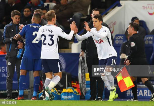 Christian Eriksen of Tottenham Hotspur is substituted for Erik Lamela during the Premier League match between Leicester City and Tottenham Hotspur at...
