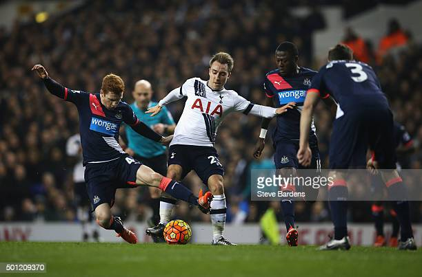 Christian Eriksen of Tottenham Hotspur is tackled by Jack Colback of Newcastle United during the Barclays Premier League match between Tottenham...